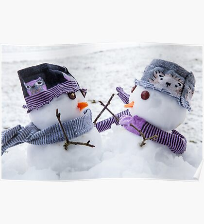 Two cute snowmen embracing as long lost friends.  Poster