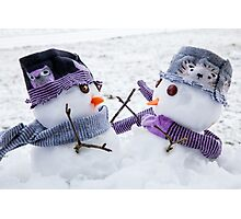 Two cute snowmen embracing as long lost friends.  Photographic Print