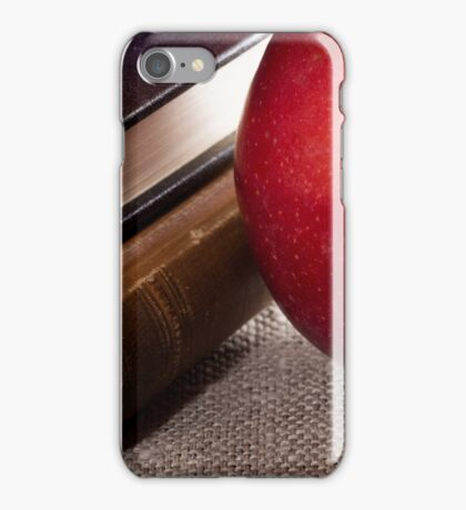Detail of old books in hardcover and close-up red apple iPhone Case/Skin