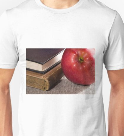 Detail of old books in hardcover and close-up red apple Unisex T-Shirt