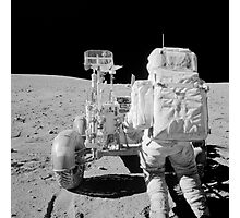Apollo 16 astronaut reaches for tools in the back of the Lunar Roving Vehicle. Photographic Print