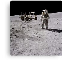 Apollo 16 astronaut collects samples on the lunar surface. Canvas Print