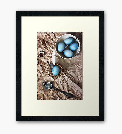 Blue easter eggs on a paper background Framed Print