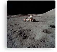 Apollo 17 astronaut driving the Lunar Roving Vehicle. Canvas Print