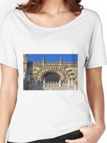 The Cathedral of Saint Mary of the See, Seville Cathedral, in Seville, Andalusia, Spain. Gothic style architecture in Spain. Women's Relaxed Fit T-Shirt