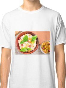 Old wooden bowl of healthy oatmeal with berries Classic T-Shirt