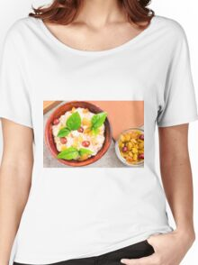 Old wooden bowl of healthy oatmeal with berries Women's Relaxed Fit T-Shirt