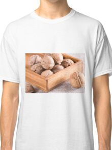 Macro view of walnuts close up in a wooden box Classic T-Shirt