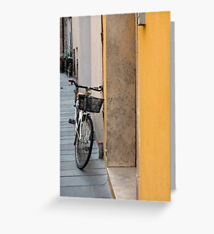 Bike near a yellow wall in Foligno, Italy Greeting Card