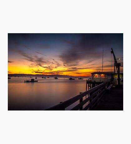 Setting the Stage Sunrise over boats in the harbor Port San Luis Harford Pier  Photographic Print