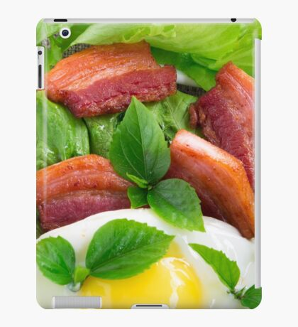 Top view on egg yolk, fried bacon and herbs iPad Case/Skin