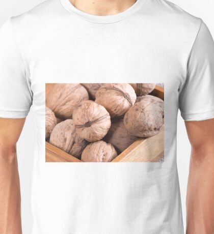 Macro view of a group of walnuts in a brown wooden box Unisex T-Shirt