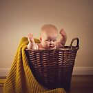 Baby in a basket by AmyMicheleW