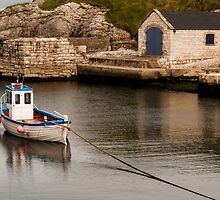Boat in Ballintoy Harbour in Northern ireland by Alan Campbell