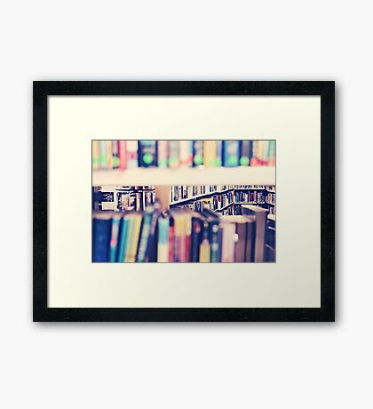 Through The Library Bookshelves Framed Print