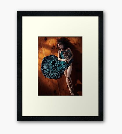 Sensual portrait of woman in green dress with bare legs lying on the floor art photo print Framed Print