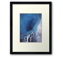 Staring into an ice hole Framed Print