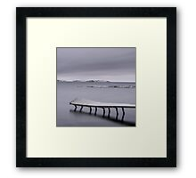 Frozen jetty over water Framed Print