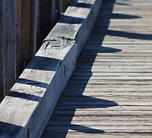 Shadows on the Pier by Gilda Axelrod