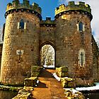 Whittington Castle gatehouse with snow by Sheila Laurens