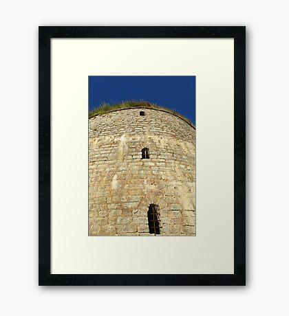 Old tower against the blue sky Framed Print