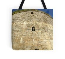 Old tower against the blue sky Tote Bag