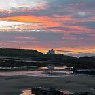 Bamburgh Lighthouse Sunset. by Dave Staton