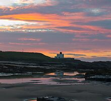 Bamburgh Lighthouse Sunset. by Dave Staton