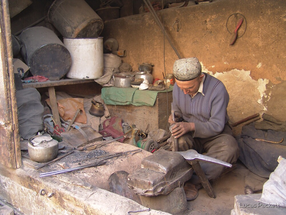 Kashgar, Uyghur Man working by Lucas Packett