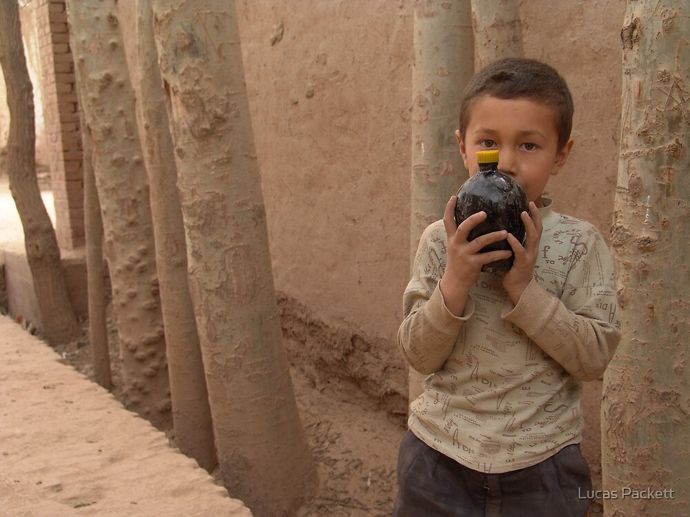 Kashgar, Young Uyghur Boy with Pomegranate juice, Old City by Lucas Packett