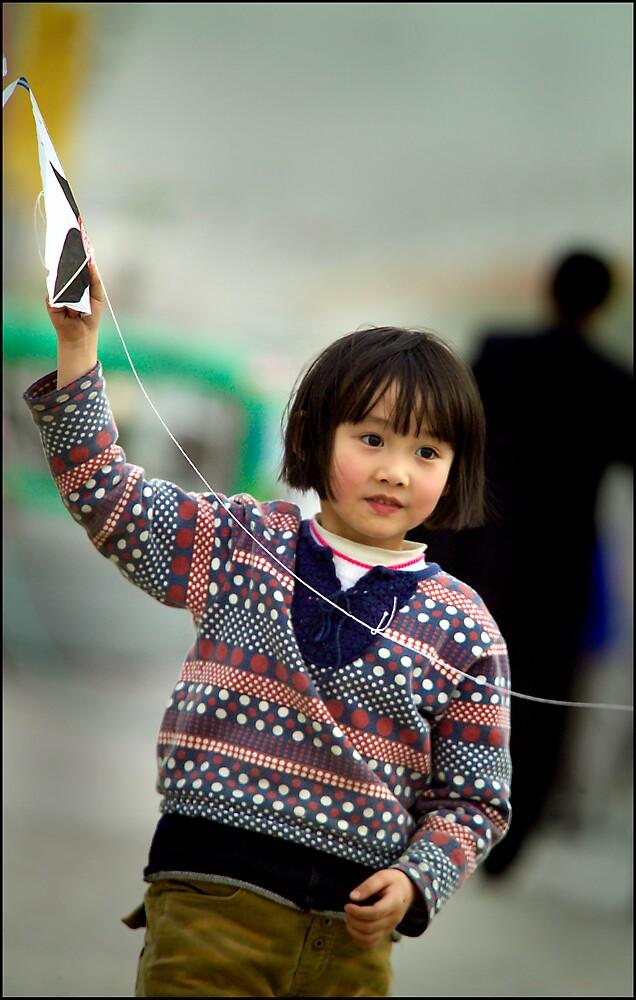 Kite girl 1, Xi'an, China 2006 by John Tozer