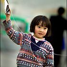 Kite girl 1, Xi'an, China 2006 by John Tozer