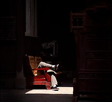 Chinese siesta, Hongcun, China 2006 by John Tozer