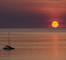 Sunset and yacht by Rob Gray