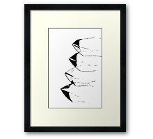 stilized kites flying in the sky Framed Print