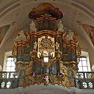 Church organ with mounted clock by Arie Koene