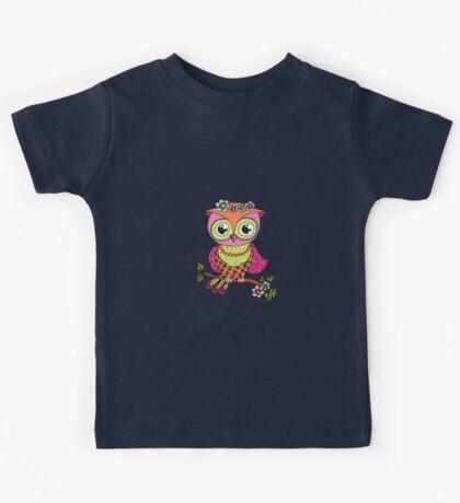 Cute colorful cartoon owl sitting on tree branch Kids Tee