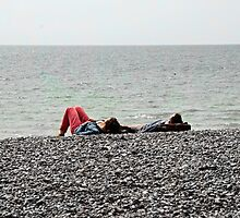 Relaxing on the beach by Roxy J
