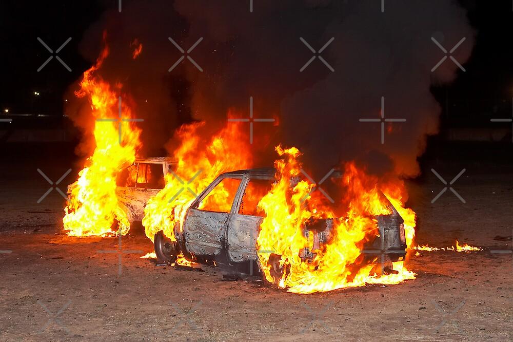 Burning cars by John Jovic