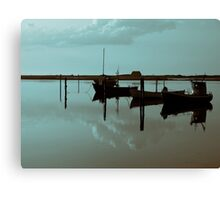 Magical reflection of a small dinghy dory boats Canvas Print
