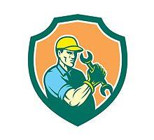 Mechanic Holding Spanner Wrench Shield Retro by patrimonio