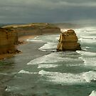 Morning Sunlight and Dark Skies, Great Ocean Rd by Joe  Mortelliti