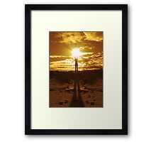 Woman holding the sun between her hands Framed Print