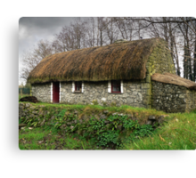Old tatched Irish country famine cottage Canvas Print