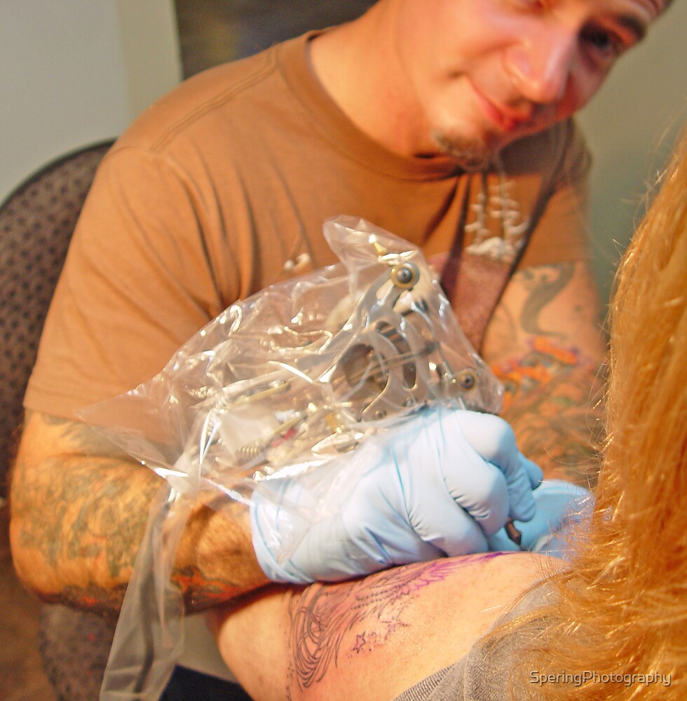 John, working on my tattoo by SperingPhotography