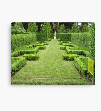 Hedges and sculpture Canvas Print