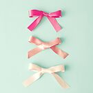 Three pink silk ribbons over pale blue by Caroline Mint