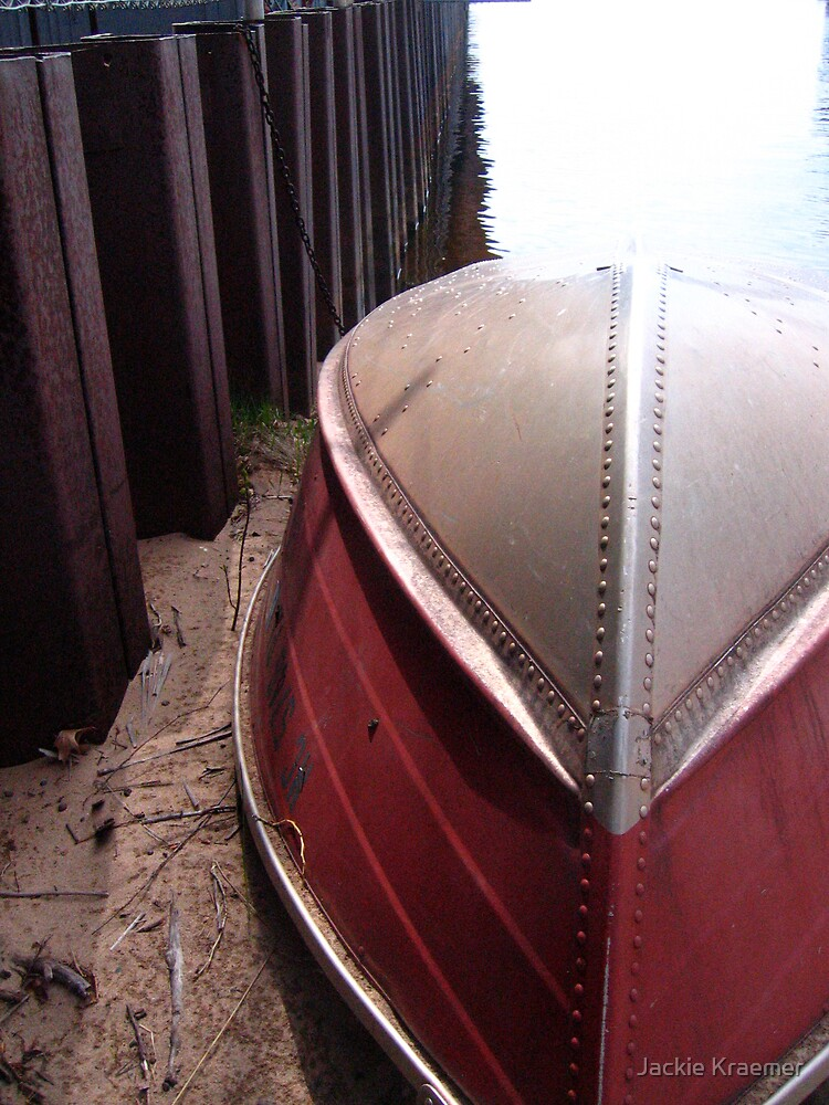 Rowboat ashore the ore dock by Jackie Kraemer