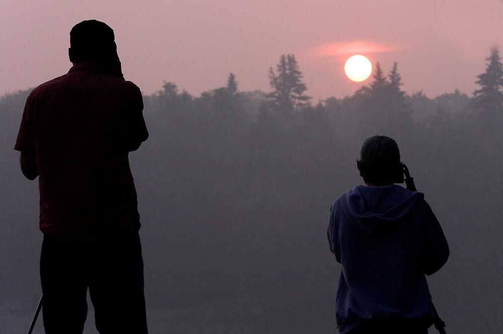 Photographers at sunrise by ScottSherman