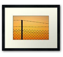 Fence at sunset Framed Print